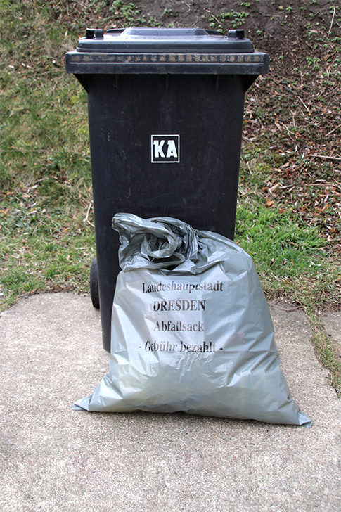 Grey bin and sack