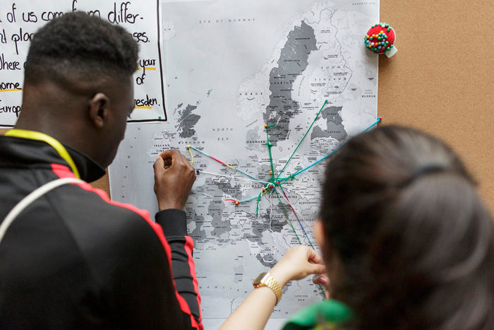 Participants putting their city name on a map