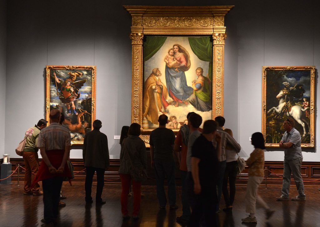 "Visitors in front of the Famous Painting ""Sistine Madonna"""