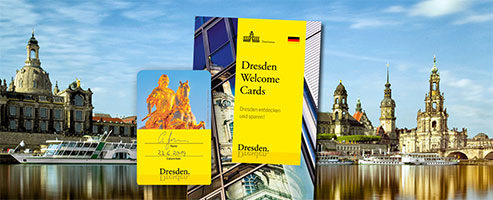 Sample card and brochure of the Dresden Welcome Cards in front of the famous city skyline of Dresden.